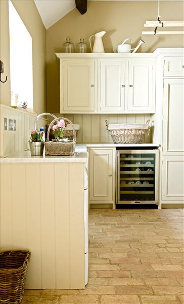 10 Traditionally styled Chichester kitchen with Carrera marble worktops and full height larder units