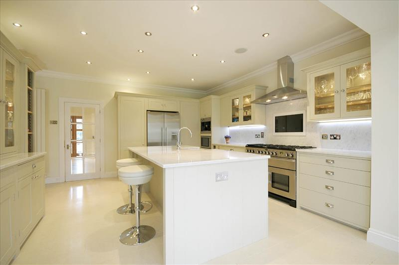 9 Impressive Neptune Suffolk kitchen with large island and glazed top cabinets providing a bright, contemporary look