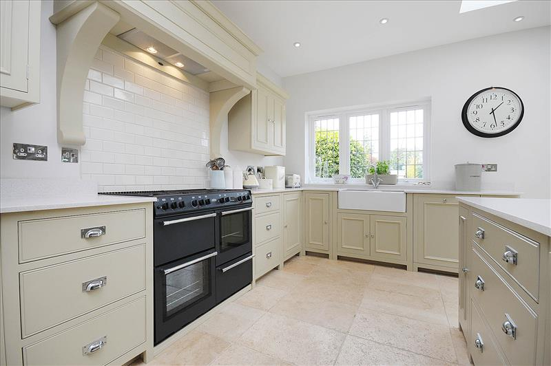 9 Neptune Chichester kitchen in Limestone with double door sink unit and large range cooker